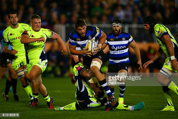 Charlie Ewels of Bath Rugby is tackled by Laurence Pearce of Sale Sharks during the Aviva Premiership match between Bath Rugby and Sale Sharks at...
