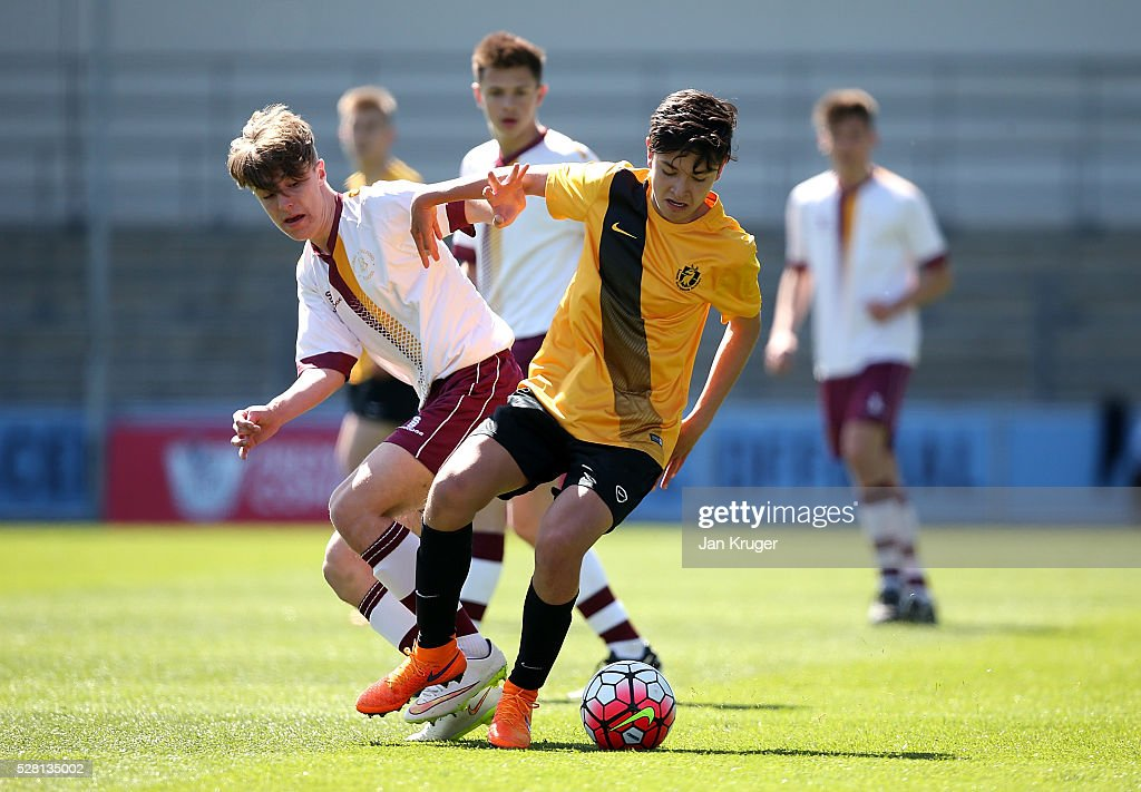 Charlie Fairclough of Thomas Telford School battles with Cameron Sharp of Samuel Whitbread Academy during the under 16 Schools' Cup final match between Thomas Telford School and Samuel Whitbread Academy at the Academy Training Ground on May 04, 2016 in Manchester, England.
