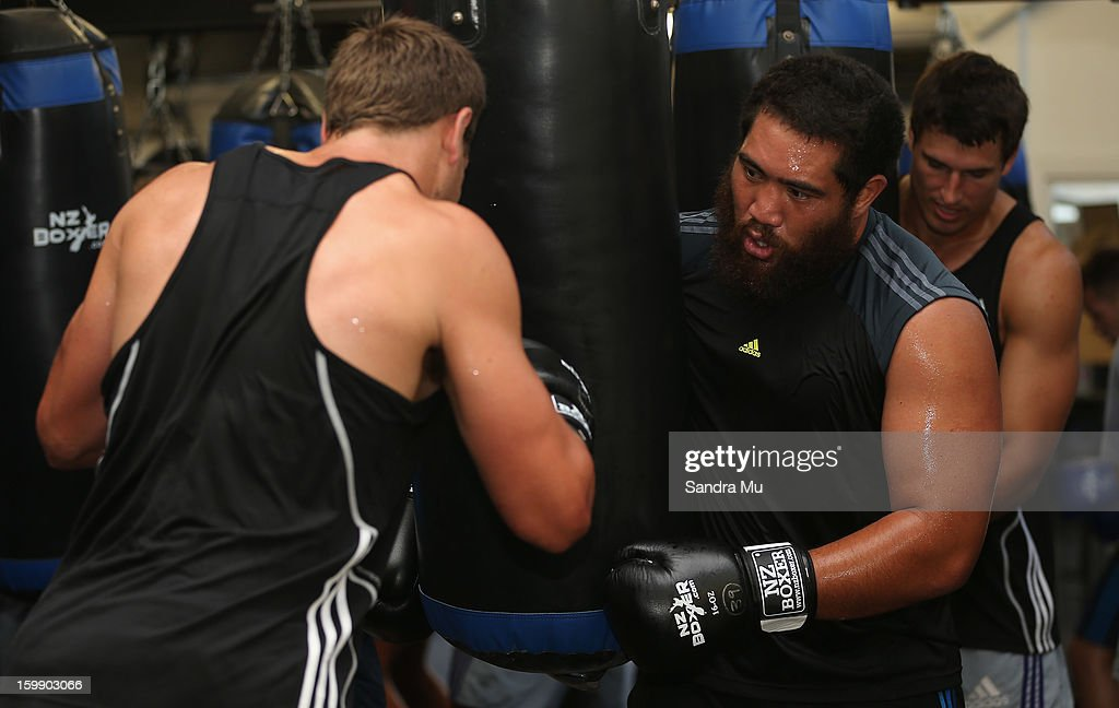 Charlie Faumuina holds the boxing bag during a Blues training session with Shane Cameron at Shane Cameron Fitness on January 23, 2013 in Auckland, New Zealand.