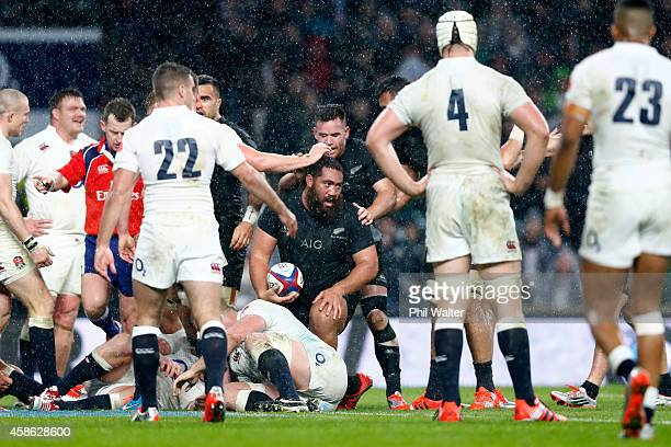 Charlie Faumuina of New Zealand is congratulated by team mates after scoring a try during the QBE International match between England and New Zealand...