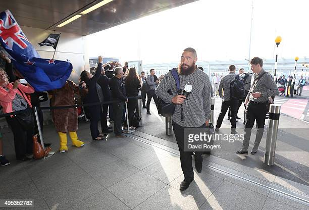 Charlie Faumuina of Rugby World Cup winners the New Zealand All Blacks arrives with team mates at Heathrow Airport at the start of their journey back...
