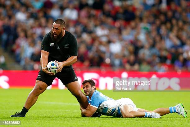 Charlie Faumuina of the All Blacks is tackled during the 2015 Rugby World Cup Pool C match between New Zealand and Argentina at Wembley Stadium on...