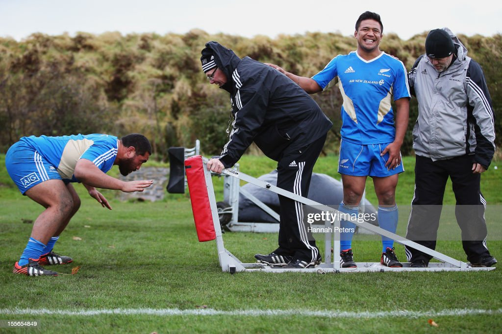 <a gi-track='captionPersonalityLinkClicked' href=/galleries/search?phrase=Charlie+Faumuina&family=editorial&specificpeople=4294873 ng-click='$event.stopPropagation()'>Charlie Faumuina</a> of the All Blacks runs through scrum drills during a training session at Peffermill University on November 6, 2012 in Edinburgh, Scotland.