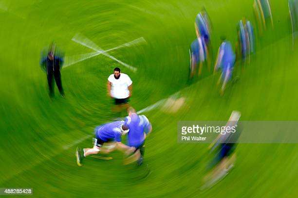 Charlie Faumuina of the New Zealand All Blacks looks on during a New Zealand All Blacks training session at the Lensbury Hotel on September 15 2015...