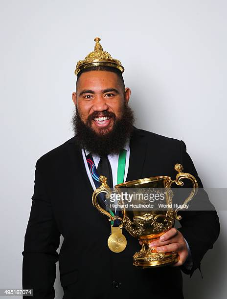 Charlie Faumuina of the New Zealand All Blacks poses with the Webb Ellis Cup after the 2015 Rugby World Cup Final match between New Zealand and...