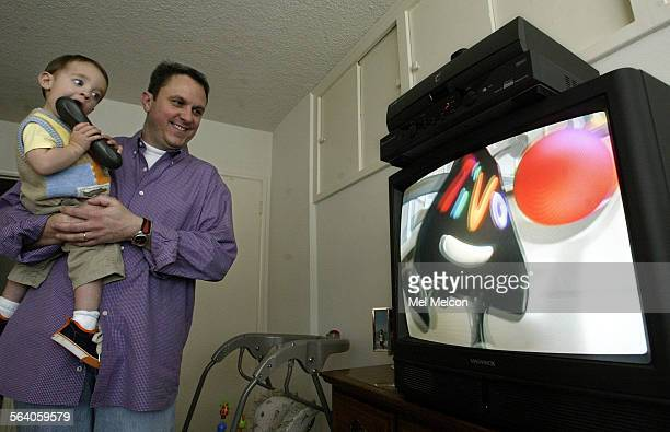 Charlie Flint and his son Chip 15 months watch television at their home in Beverly Hills on Monday morning A TiVo digital video recorder is hooked up...
