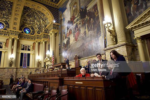 Charlie Gerow and fellow tellers count the elector's votes from a ballot box in the House of Representatives chamber of the Pennsylvania Capitol...
