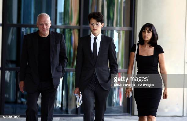 Charlie Gilmour leaves Kingston Crown Court with his father David Gilmour and mother Polly where he appeared to be sentenced after pleading guilty to...