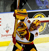 Charlie Graham of the Belleville Bulls makes a save against the Mississauga Steelheads during OHL game action on January 16 2015 at the Hershey...