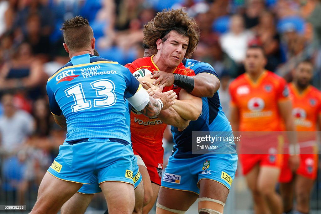 Charlie Gubb of the Warriors is tackled during the NRL Trial Match between the New Zealand Warriors and the GOld Coast Titans at Toll Stadium on February 13, 2016 in Whangarei, New Zealand.