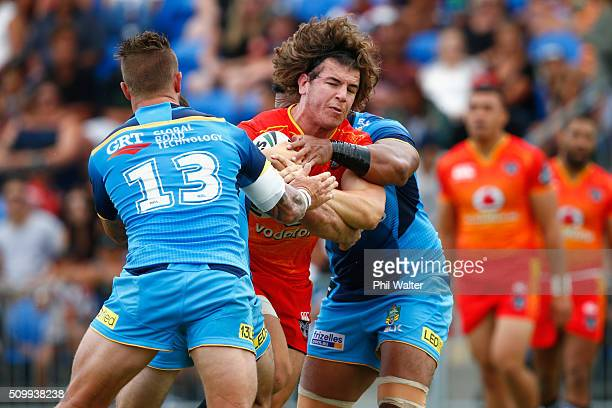 Charlie Gubb of the Warriors is tackled during the NRL Trial Match between the New Zealand Warriors and the GOld Coast Titans at Toll Stadium on...