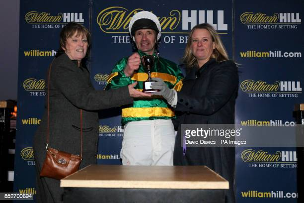Charlie Hancock receives his prize after his victory in the final of The William Hill Camel Derby at Chepstow Racecourse