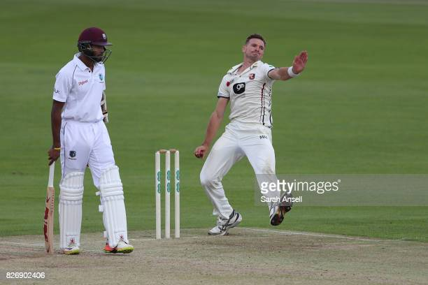Charlie Hartley of Kent bowls as Kyle Hope of West Indies backs up during day one of the tour match between Kent and West Indies at The Spitfire...