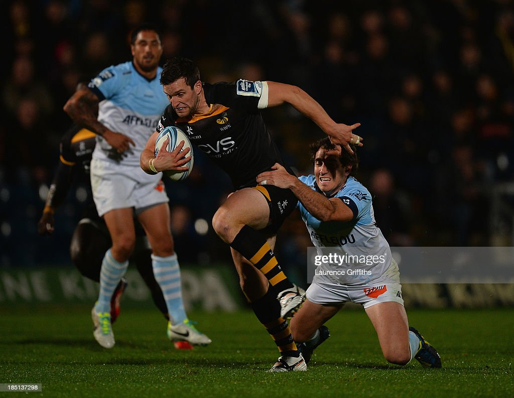Charlie Hayter of London Wasps is tackled by Santiago Fernandez of Bayonne during the Amlin Challenge Cup round two match between London Wasps and Bayonne at Adams Park on October 17, 2013 in High Wycombe, England.