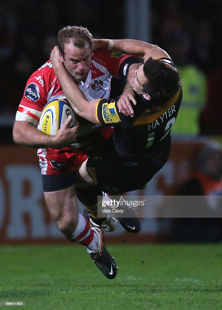 Charlie Hayter of London Wasps tackles James SimpsonDaniel of of Gloucester during the Aviva Premiership match between Gloucester and London Wasps at...