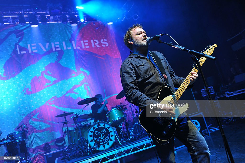 Charlie Heather and Mark Chadwick of The Levellers perform on stage at O2 Shepherd's Bush Empire on November 24, 2012 in London, England.