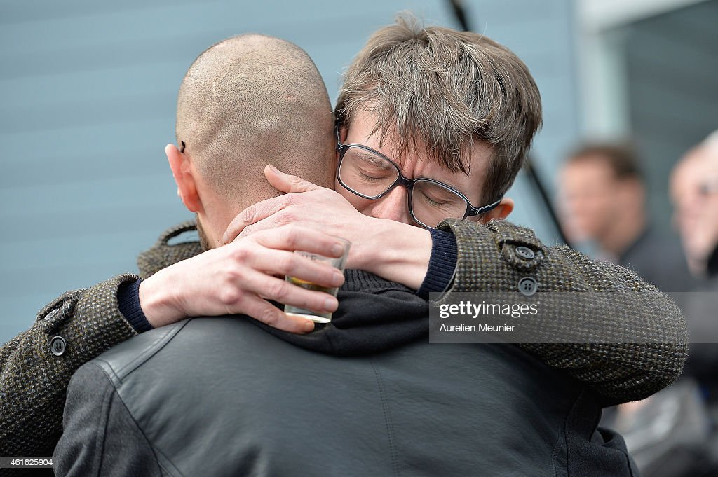 Charlie Hebdo cartoonist Renald Luzier (L) aka 'Luz' comforts another mourner after the funeral service of Charlie Hebdo editor and cartoonist Stephane Charbonnier aka 'Charb' in his hometown on January 16, 2015 in Pontoise, France. Charlie Hebdo's editor Stephane Charbonnier was amoungst those killed in last weeks terrorist attack on the satirical newspaper.