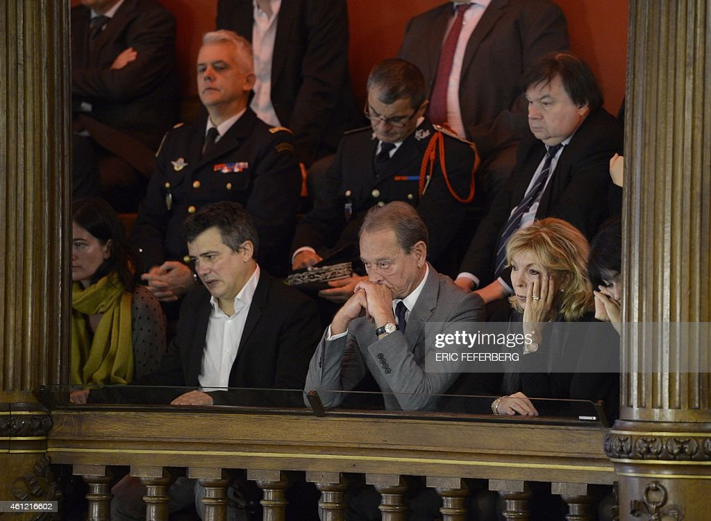 Charlie Hebdo journalist Patrick Pelloux (2nd L), former Paris Mayor Betrand Delanoe (2nd R) and the widow of Charlie Hebdo cartoonist <a gi-track='captionPersonalityLinkClicked' href=/galleries/search?phrase=Georges+Wolinski&family=editorial&specificpeople=2077652 ng-click='$event.stopPropagation()'>Georges Wolinski</a>, <a gi-track='captionPersonalityLinkClicked' href=/galleries/search?phrase=Maryse+Wolinski&family=editorial&specificpeople=7474415 ng-click='$event.stopPropagation()'>Maryse Wolinski</a>, attend a meeting on January 9, 2015 at the Paris City Hall as the city made the weekly satirical magazine an honorary citizen of Paris following the January 7 massacre at the weekly, which left 12 dead. AFP PHOTO / ERIC FEFERBERG