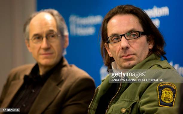 Charlie Hebdo's editorinchief Gerard Biard listens as film critic JeanBaptiste Thoret speaks at the Freedom House in Washington DC on May 1 2015 AFP...