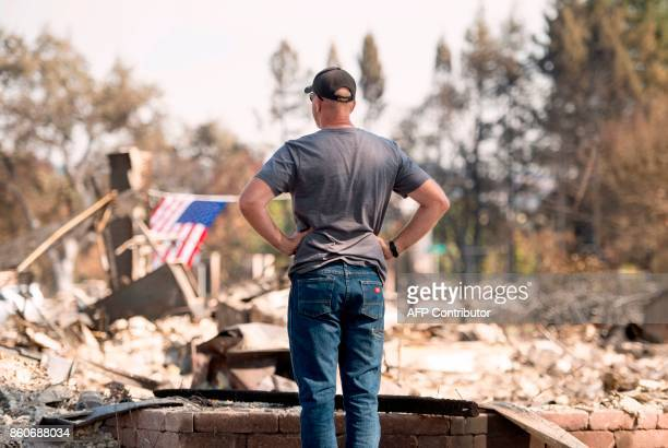 Charlie Higgins looks over his burned home in Santa Rosa California on October 12 2017 Hundreds of people are still missing in massive wildfires...