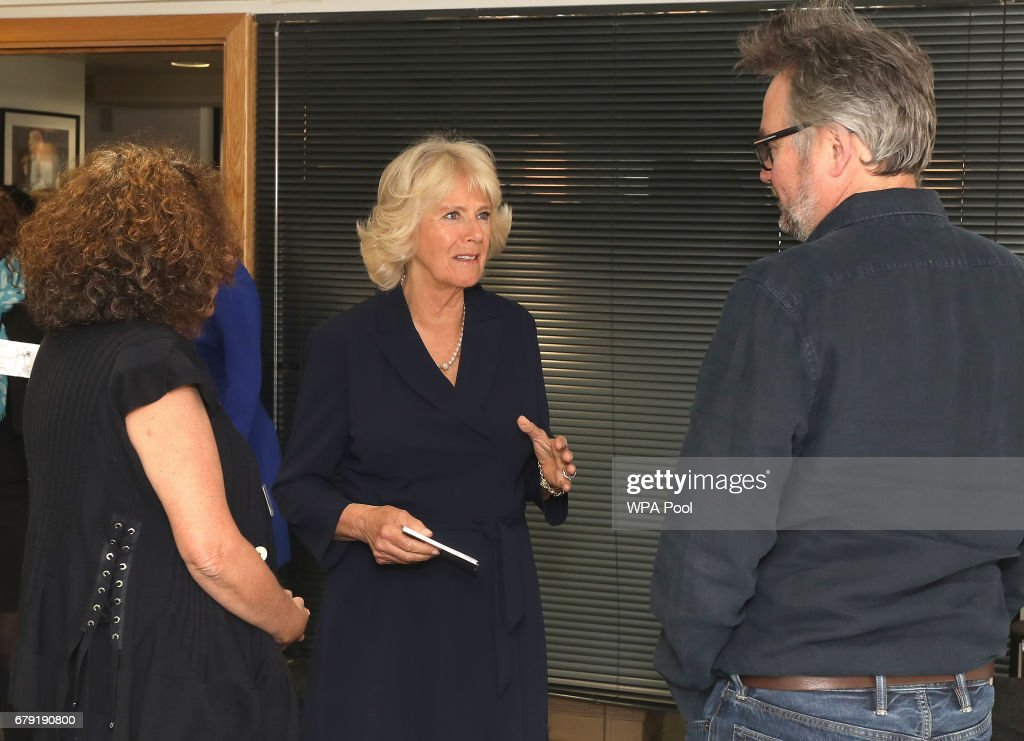 Charlie Higson greets Camilla, Duchess of Cornwall as she joins the '500 Word' judging panel, a creative writing competition, at BBC Radio 2 Studios on May 4, 2017 in London, England.