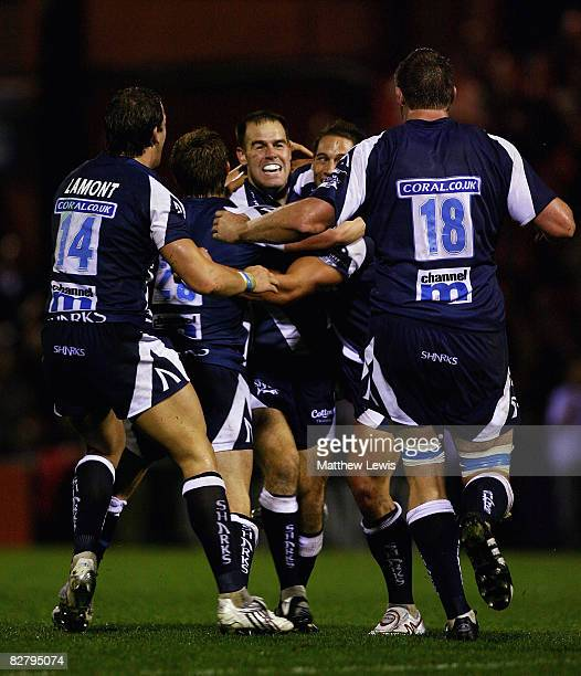 Charlie Hodgson of Sale is congratulated by team mates after his drop goal won the game during the Guinness Premiership match between Sale Sharks and...
