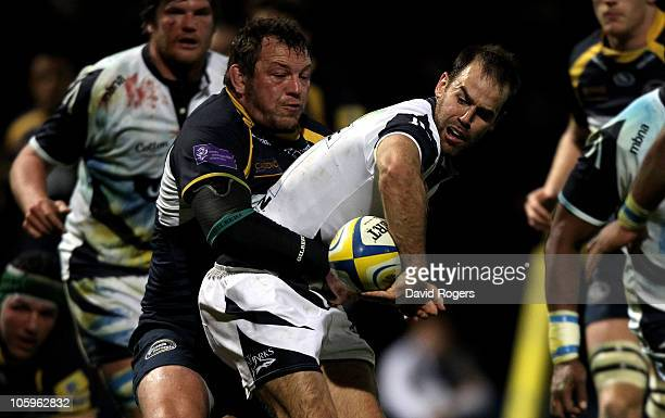 Charlie Hodgson of Sale is tackled by Steve Thompson during the Aviva Premiership match between Leeds Carnegie and Sale Sharks at Headingley Carnegie...