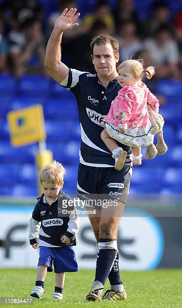 Charlie Hodgson of Sale Sharks salutes the fans as he takes part in a lap of honour with his children following the AVIVA Premiership match between...
