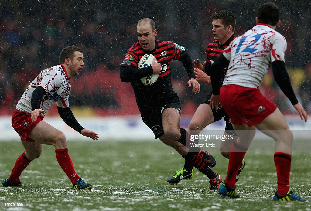 Charlie Hodgson of Saracens breaks through to score the bonus try during the Heineken Cup match between Saracens and Edinburgh Rugby at Vicarage Road on January 20, 2013 in Watford, England.
