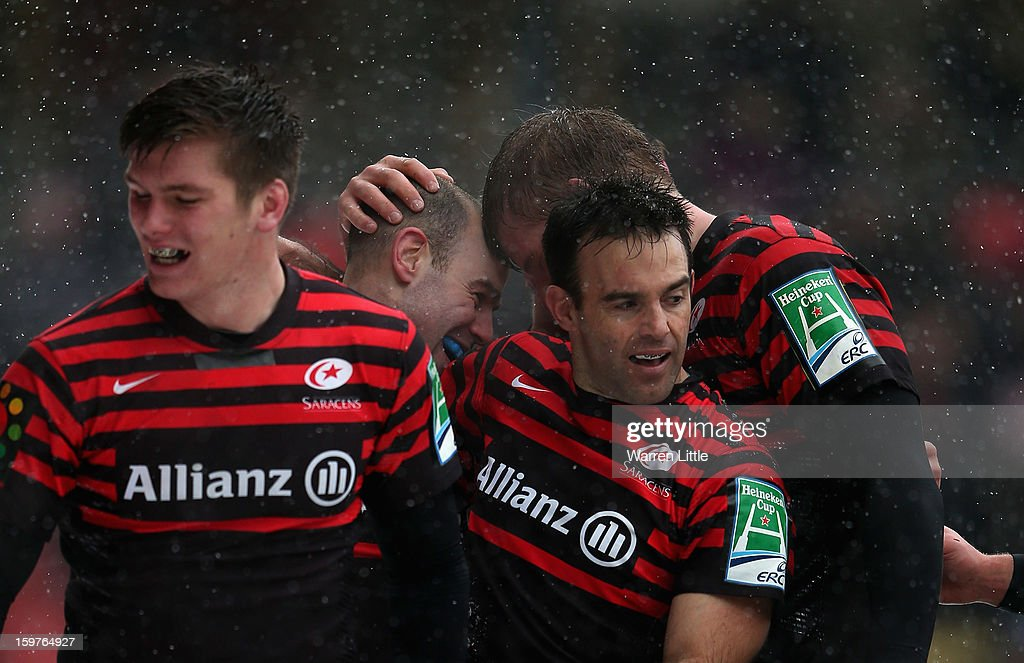 Charlie Hodgson of Saracens is congratulated after scoring the bonus point try during the Heineken Cup match between Saracens and Edinburgh Rugby at Vicarage Road on January 20, 2013 in Watford, England.