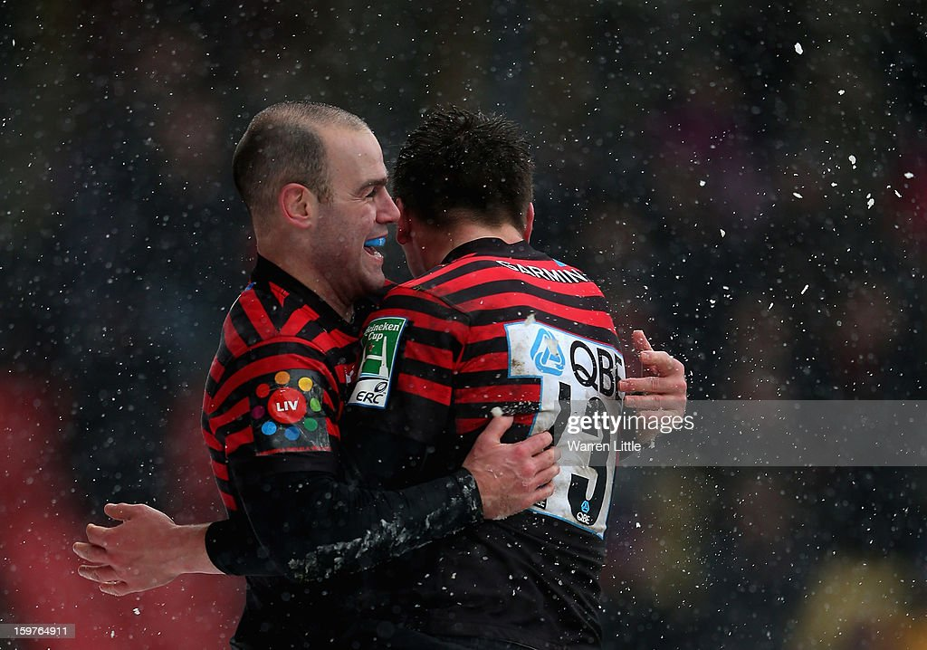 Charlie Hodgson of Saracens is congratulated by his team mates after scoring the bonus point try during the Heineken Cup match between Saracens and Edinburgh Rugby at Vicarage Road on January 20, 2013 in Watford, England.