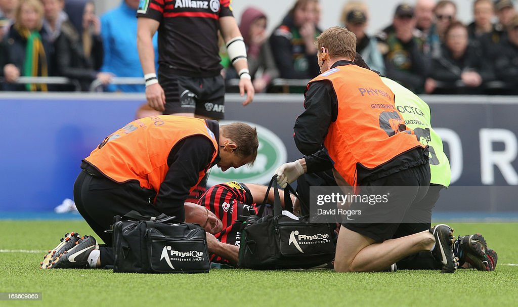 Charlie Hodgson of Saracens receives attention during the Aviva Premiership semi final match between Saracens and Northampton Saints at Allianz Park on May 12, 2013 in Barnet, England.