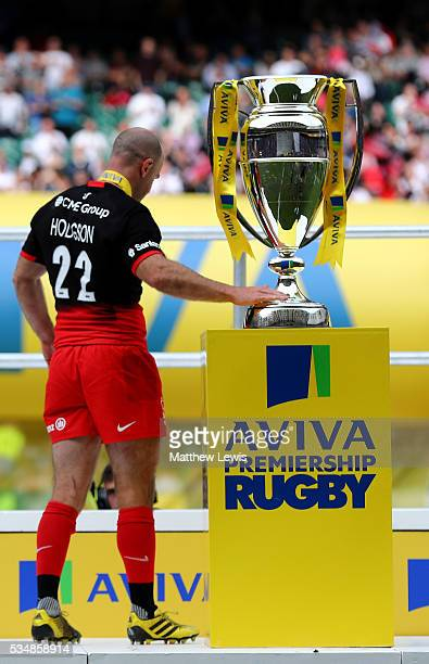 Charlie Hodgson of Saracens touches the trophy at the ceremony after the Aviva Premiership final match between Saracens and Exeter Chiefs at...