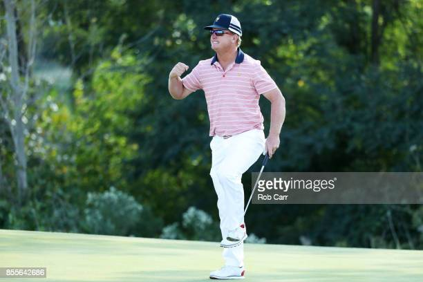 Charlie Hoffman of the US Team celebrates on the 13th green after he and Kevin Chappell of the US Team defeated Anirban Lahiri of India and the...