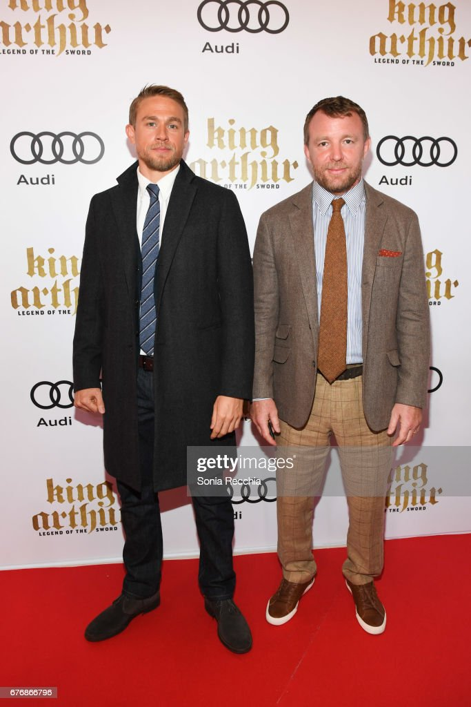 charlie hunnam and guy ritchie arrive at the scotiabank theatre for the canadian red carpet screening