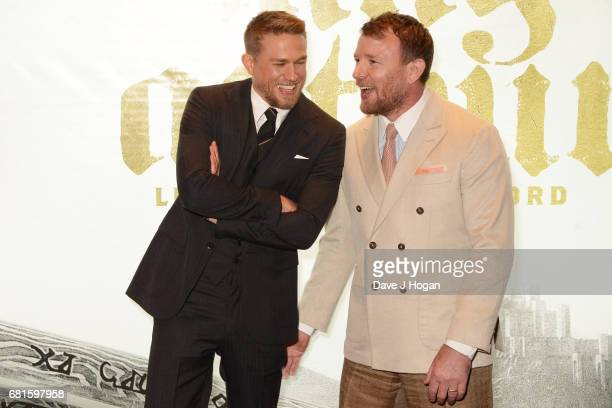 Charlie Hunnam and Guy Ritchie attend the European premiere of 'King Arthur Legend of the Sword' at Cineworld Empire on May 10 2017 in London United...