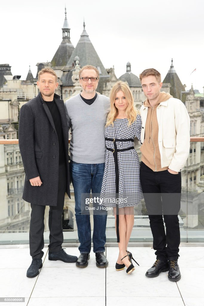 Charlie Hunnam, James Gray, Sienna Miller and Robert Pattinson pose at a photocall for 'The Lost City Of Z' at Corinthia London on February 16, 2017 in London, England.