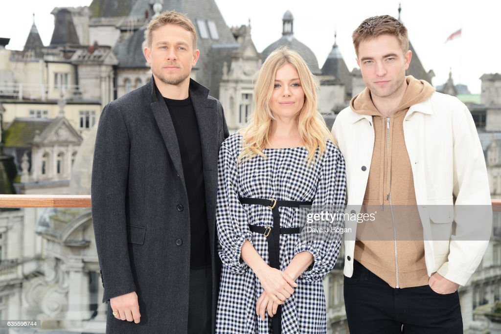 Charlie Hunnam, Sienna Miller and Robert Pattinson pose at a photocall for 'The Lost City Of Z' at Corinthia London on February 16, 2017 in London, England.