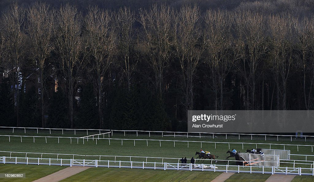 Charlie Huxley riding Marie Des Anges jump a fence down the back straight before winning The Balreed Supporting Gretwood Novices' Handicap Steeple Chase at Newbury racecourse on March 02, 2013 in Newbury, England.