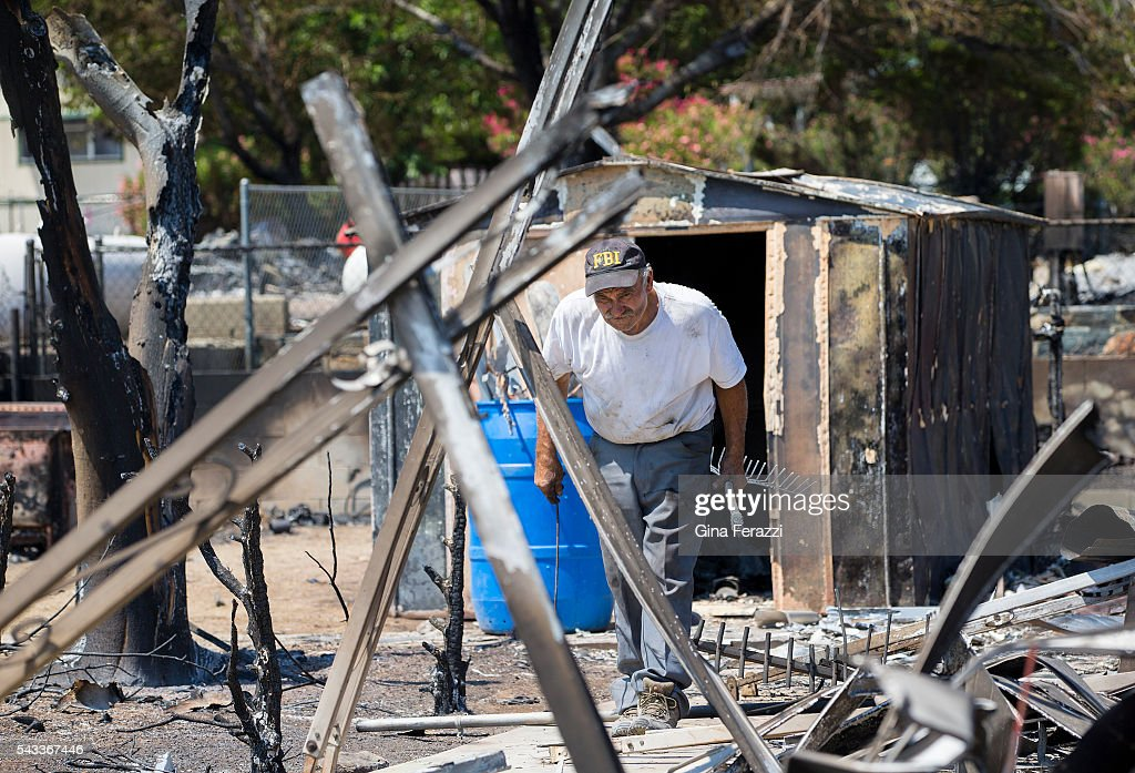 Charlie Johnson helps look for any valuables on a friend's property destroyed during the Erskine Fire June 27, 2016 in South Lake, California.