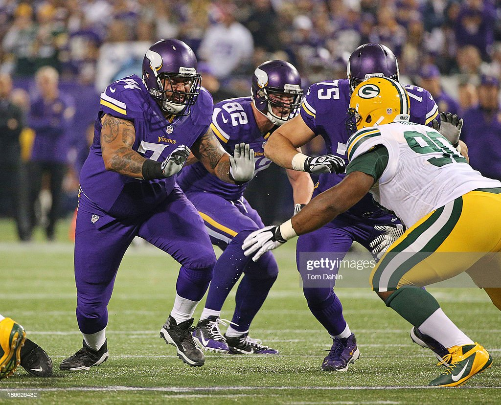 Charlie Johnson #74 of the Minnesota Vikings blocks during an NFL game against the Green Bay Packers at Mall of America Field at the Hubert H. Humphrey Metrodome on October 27, 2013 in Minneapolis, Minnesota.