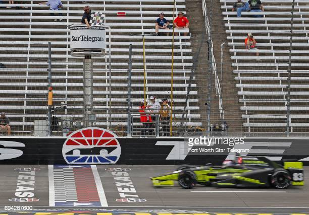 Charlie Kimball crosses the start/finish line to take the checkered flag qualifying on the pole for the Rainguard Water Sealers 600 during Verizon...