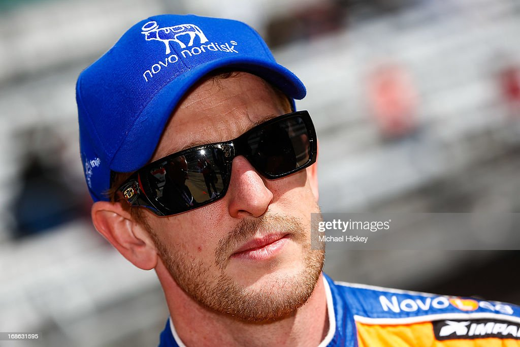 Charlie Kimball driver of the #83 Novo Nordisk Chip Ganassi Racing Dallara Honda talks with a reporter during Indianapolis 500 practice at the Indianapolis Motor Speedway on May 12, 2013 in Indianapolis, Indiana.