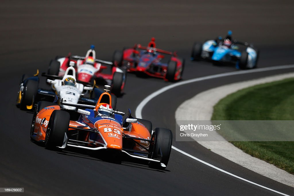 Charlie Kimball driver of the #83 Novo Nordisk Ganassi Racing Honda Dallara leads a pack of cars during final practice on Carb Day for the 97th Indianapolis 500 mile race at Indianapolis Motor Speedway on May 24, 2013 in Indianapolis, Indiana.