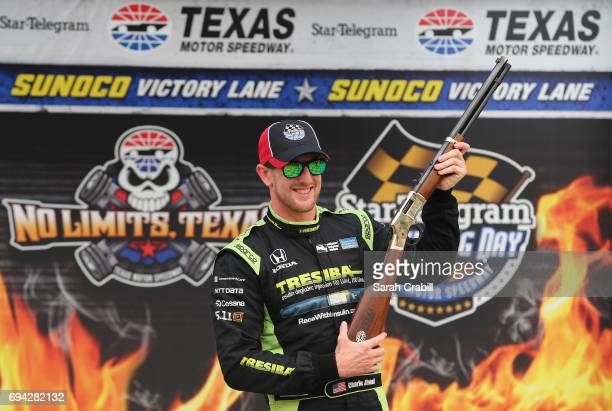 Charlie Kimball driver of the Tresiba Chip Ganassi Racing Teams Honda poses for a photo after winning the pole award after qualifying for the Verizon...