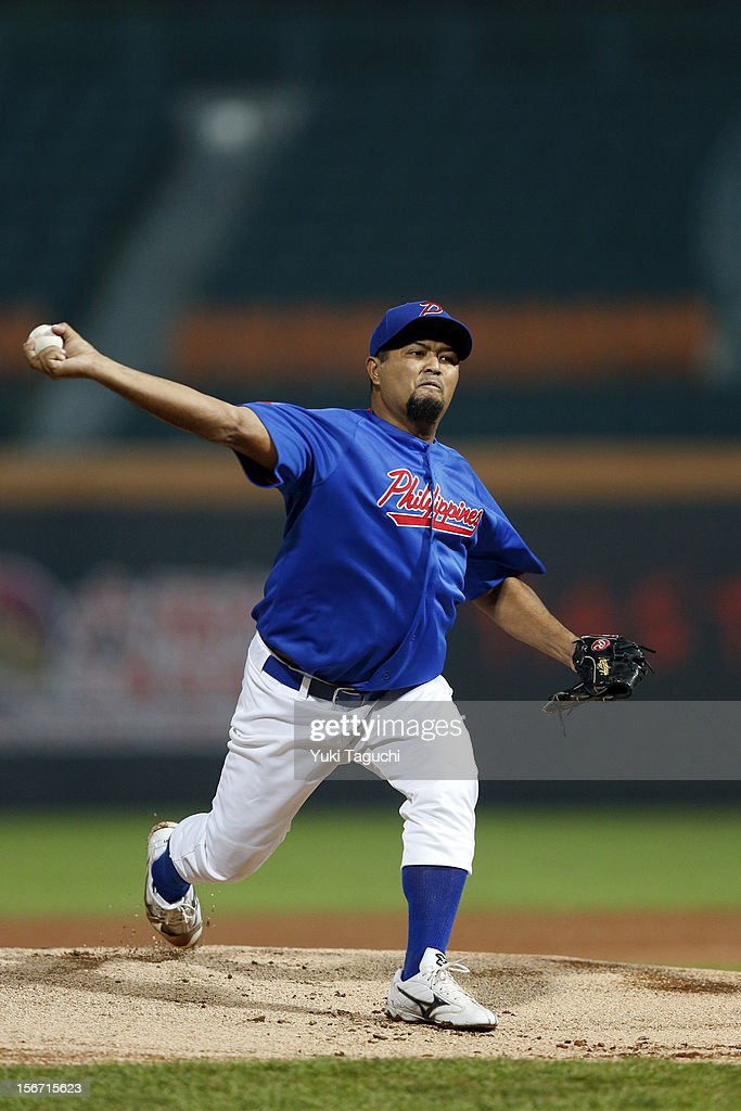 Charlie Labrador #17 of Team Philippines pitches during Game 5 of the 2013 World Baseball Classic Qualifier against Team New Zealand at Xinzhuang Stadium in New Taipei City, Taiwan on Saturday, November 17, 2012.