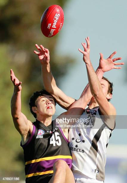 Charlie Lee of the Rebels and Jack Kirley of the Bushrangers compete for the ball during the round 10 TAC Cup match between the North Ballarat Rebels...