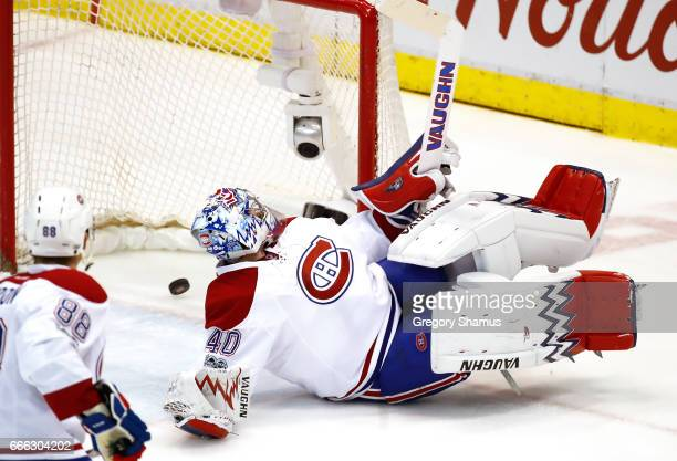 Charlie Lindgren of the Montreal Canadiens looks back at the puck over the goal line after a shot from Dylan Larkin of the Detroit Red Wings during...