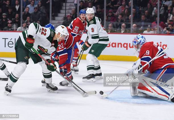 Charlie Lindgren of the Montreal Canadiens makes a save in front of Nino Niederreiter of the Minnesota Wild in the NHL game at the Bell Centre on...
