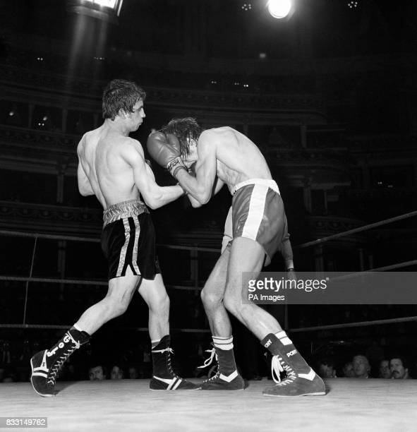 Charlie Magri the unbeaten British Flyweight champion lands a punishing blow to body of his Spanish opponent Manuel Carrasco ranked eighth in Europe...